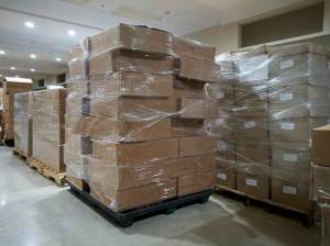 Pallets of media arrive to be digitized.